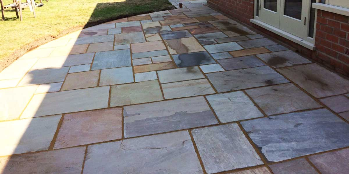 Flagged Patios re-laid and pointed